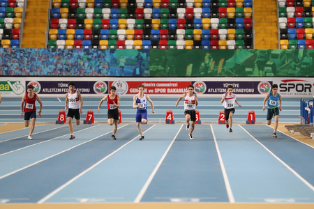 metres: ISTANBUL, TURKEY - JANUARY 15, 2017: Athletes running 60 metres during Turkish Athletic Federation Indoor Athletics Record Attempt Races Editorial