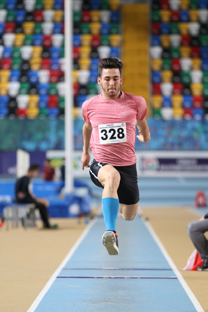 ISTANBUL, TURKEY - JANUARY 15, 2017: Athlete Eray Yalcin triple jumping during Turkish Athletic Federation Indoor Athletics Record Attempt Races Editorial