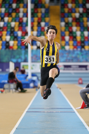 ISTANBUL, TURKEY - JANUARY 15, 2017: Athlete Batuhan Cakir triple jumping during Turkish Athletic Federation Indoor Athletics Record Attempt Races