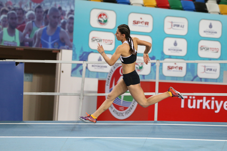 attempt: ISTANBUL, TURKEY - JANUARY 15, 2017: Athlete Busra Atalay running during Turkish Athletic Federation Indoor Athletics Record Attempt Races