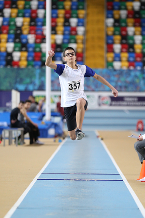 ISTANBUL, TURKEY - JANUARY 15, 2017: Athlete Ege Arslan triple jumping during Turkish Athletic Federation Indoor Athletics Record Attempt Races Editorial