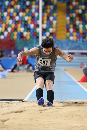 ISTANBUL, TURKEY - JANUARY 15, 2017: Athlete Mustafa Ayberk Bektas triple jumping during Turkish Athletic Federation Indoor Athletics Record Attempt Races