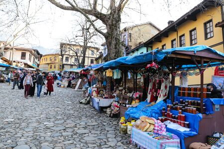 BURSA, TURKEY - MARCH 18, 2017: People shopping in old Ottoman village Cumalikizik in Bursa City. Village located 10 kilometers east of the city of Bursa, at the foot of Mount Uludag.