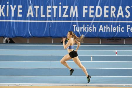 ISTANBUL, TURKEY - JANUARY 29, 2017: Athlete Buket Katya Orhonsayin running during Turkish Athletic Federation Indoor Olympic Record Attempt Races
