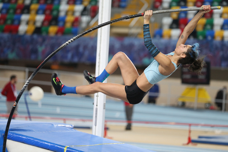 attempt: ISTANBUL, TURKEY - JANUARY 28, 2017: Athlete Buse Arikazan pole vaulting during Turkish Athletic Federation Indoor Olympic Record Attempt Races