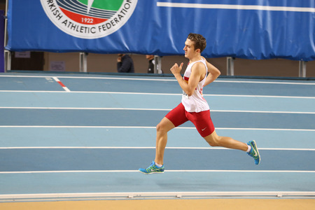 attempt: ISTANBUL, TURKEY - JANUARY 29, 2017: Athlete Sevki Kerim Mamati running during Turkish Athletic Federation Indoor Olympic Record Attempt Races