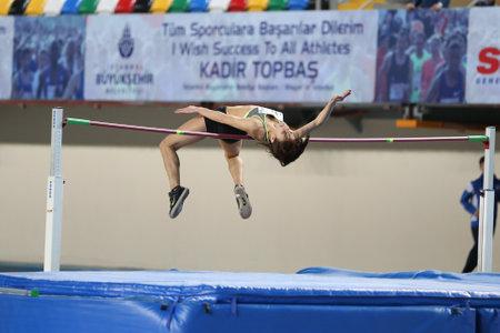 pinar: ISTANBUL, TURKEY - JANUARY 14, 2017: Athlete Pinar Aday high jumping during Ruhi Sarialp Jumping Championship Editorial