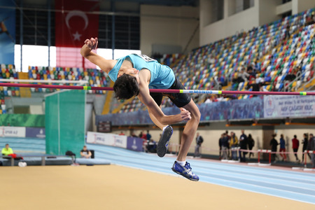 ISTANBUL, TURKEY - FEBRUARY 04, 2017: Athlete Adil Karakas high jumping during Turkcell Turkish Youth Indoor Championships Stok Fotoğraf - 76028679