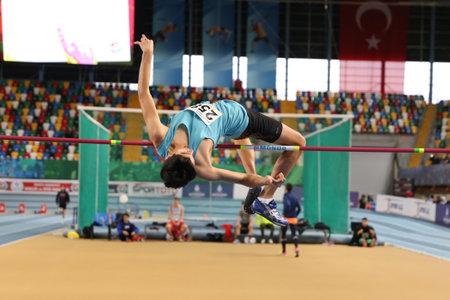 ISTANBUL, TURKEY - FEBRUARY 04, 2017: Athlete Adil Karakas high jumping during Turkcell Turkish Youth Indoor Championships