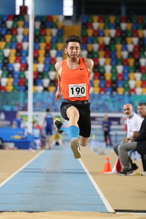 ISTANBUL, TURKEY - FEBRUARY 05, 2017: Athlete Eray Yalcin long jumping during Turkcell Turkish Youth Indoor Championships Editorial