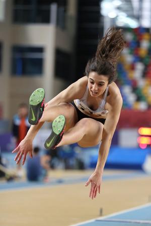 ISTANBUL, TURKEY - FEBRUARY 05, 2017: Athlete Seyma Birinci long jumping during Turkcell Turkish Youth Indoor Championships