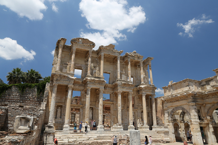IZMIR, TURKEY - JUNE 20, 2017: People visit Library of Celsus in Ephesus. Library of Celsus built in 117 A.D. and one of the most touristy place in Turkey.