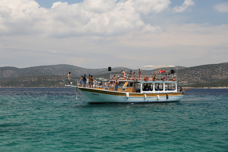 MUGLA, TURKEY - JUNE 18, 2017: People have fun and relaxing in boat tour around Bodrum Town,  Aegean sea.