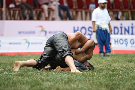 ISTANBUL, TURKEY - JULY 30, 2017: Oil wrestlers compete in Beylikduzu oil wrestling festival. Oil wrestling also called grease wrestling is the Turkish traditional sport.