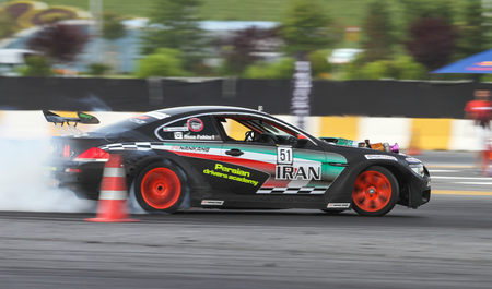 tire tracks: ISTANBUL, TURKEY - JULY 29, 2017: Fahim Reza Keykhosravi drives BMW Engine S85 Turbo Charge in Apex Masters Turkish Drift Series Istanbul Race.