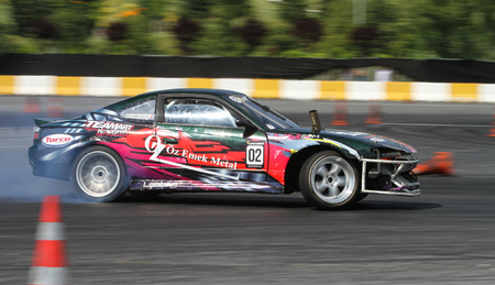tire tracks: ISTANBUL, TURKEY - JULY 29, 2017: Oktay Kabaktas drives Nissan 200SX S14A - S15 Body of TeamART Motorsport in Apex Masters Turkish Drift Series Istanbul Race.