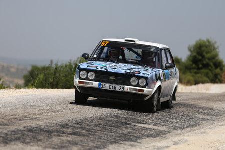 CANAKKALE, TURKEY - JULY 02, 2017: Ali Nijad Sirel drives Fiat 131 in Rally Troia