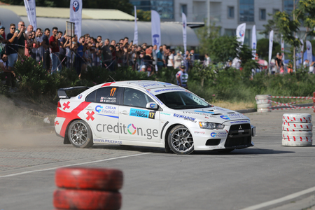 CANAKKALE, TURKEY - JULY 01, 2017: Alexander Lomadze drives Mitsubishi Lancer Evo X of MS Racing Team in Rally Troia Editorial
