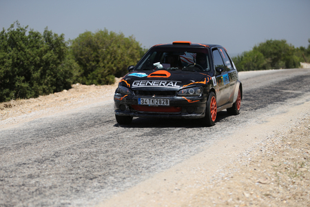 CANAKKALE, TURKEY - JULY 02, 2017: Uygar Bilgili drives Peugeot 106 GTI in Rally Troia Editorial