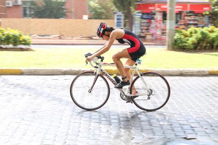 ANTALYA, TURKEY - SEPTEMBER 30, 2017: Athlete competing in cycling component of Alanya Triathlon.