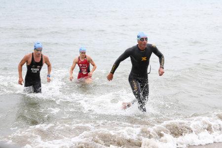 ANTALYA, TURKEY - SEPTEMBER 30, 2017: Athletes competing in swimming component of Alanya Triathlon.