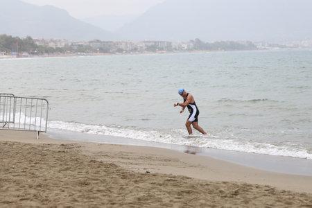 ANTALYA, TURKEY - SEPTEMBER 30, 2017: Athlete competing in swimming component of Alanya Triathlon.