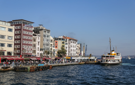 ISTANBUL, TURKEY - OCTOBER 15, 2017: People in Karakoy district and Karakoy Ferry port