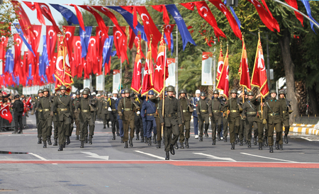 ISTANBUL, TURKEY - OCTOBER 29, 2017: Soldiers march with flags during 29 October Republic Day of Turkey parade in Vatan Avenue Editorial