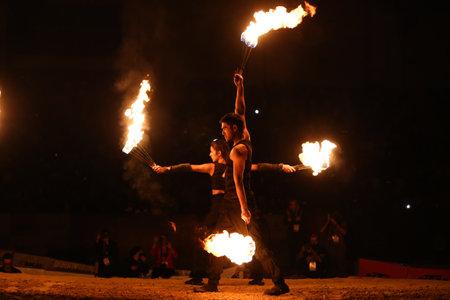 ISTANBUL, TURKEY - NOVEMBER 25, 2017: Fire dancers perform during Istanbul Superenduro championship in Atakoy Athletics Arena.