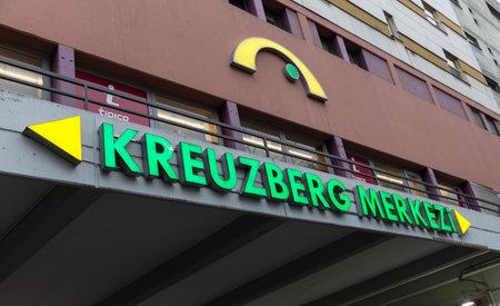 BERLIN, GERMANY - DECEMBER 16, 2017: Building with Kreuzberg Merkezi (Center) signboard in Kottbusser Tor where large number of Turkish immigrants live.