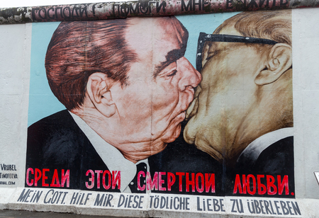 BERLIN, GERMANY - DECEMBER 16, 2017: Mural painted over Berlin Wall in East Side Gallery where the largest open air gallery in the world