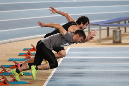 ISTANBUL, TURKEY - DECEMBER 23, 2017: Athletes running 60 meters during Turkish Athletic Federation Indoor Athletics Record Attempt Races Editorial
