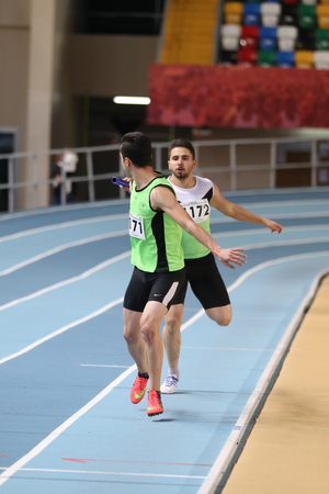 ISTANBUL, TURKEY - DECEMBER 23, 2017: Athletes running 4 × 400 metres relay during Turkish Athletic Federation Indoor Athletics Record Attempt Races