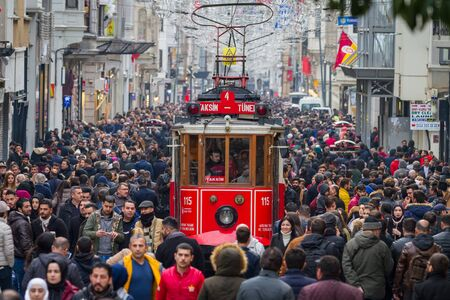 ISTANBUL, TURKEY - JANUARY 20, 2018: Historic Red Tram on Istiklal Street where the most popular destination of Istanbul for shopping and entertainment. Редакционное