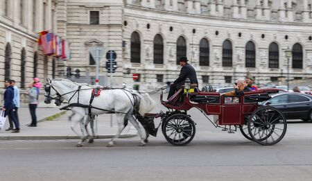VIENNA, AUSTRIA - AUGUST 26, 2018: People touring in Coach in Hofburg palace
