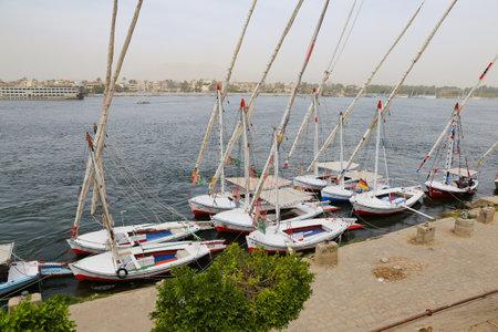 LUXOR, EGYPT - MARCH 24, 2019: Felluca boats waiting in Nile River coast