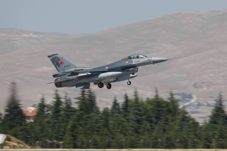 KONYA, TURKEY - JUNE 26, 2019: Turkish Air Force General Dynamics F-16C Fighting Falcon (CN 4R-12) takes off from Konya Airport during Anatolian Eagle Air Force Exercise