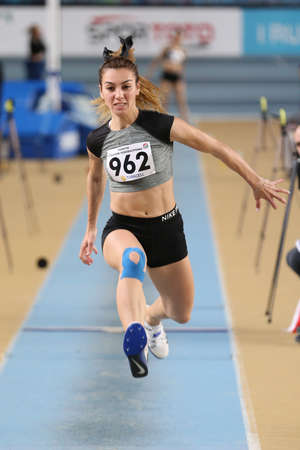 ISTANBUL, TURKEY - FEBRUARY 29, 2020: Undefined athlete triple jumping during Ruhi Sarialp Jumping Events Indoor Cup
