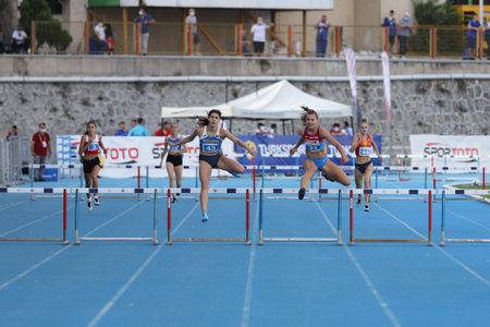 ISTANBUL, TURKEY - SEPTEMBER 12, 2020: Athletes running 400 metres hurdles during Balkan U20 Athletics Championships