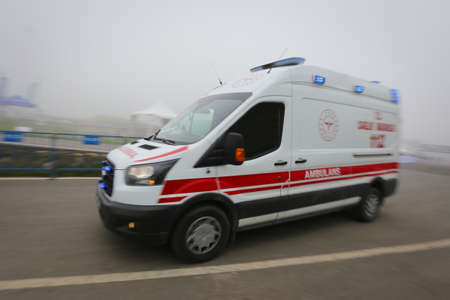 Ambulance van on way with motion blur and flashing lights