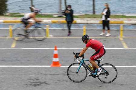 ISTANBUL, TURKEY - OCTOBER 18, 2020: Athletes competing in cycling component of Istanbul Sprint Triathlon