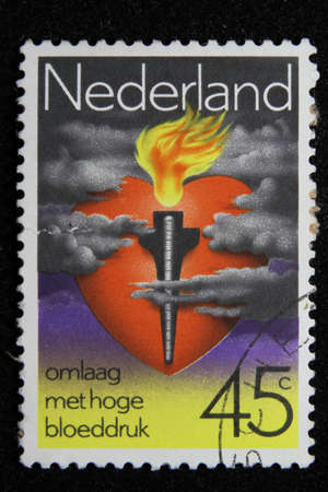 ISTANBUL, TURKEY - DECEMBER 25, 2020: Holland stamp shows Heart, Torch, Gauge and Clouds circa 1978