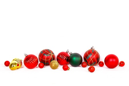 Minimalistic festive composition with colorful matte christmas balls. Fancy beautiful decoration for christmas pine tree. Background, copy space, close up, front view. Stock Photo