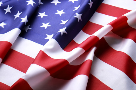 Close up of ruffled American flag. Patriots day, memorial weekend, veterans day, presidents day, independence day background. United States of America national stars and stripes symbol. Copy space.