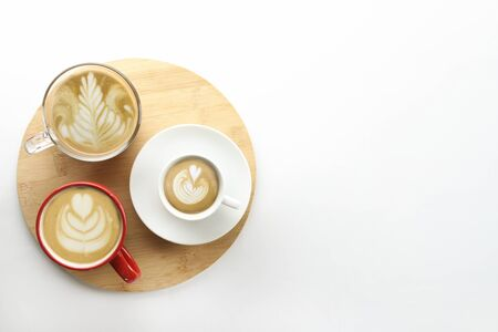 Buch of coffee cups with different kind of beverage and different latte art foam designs. Top view, close up, copy space, background.