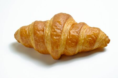 Studio shot of appealing plain mini croissant baked to golden crisp isolated on white background. Traditional french pastry. Close up, copy space, top view.