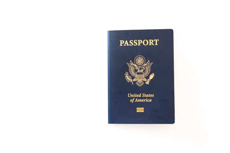 Latest version of United States of America citizen Passport with biometric ID chip. Person identification document isolated on white. Close up, copy space, background.