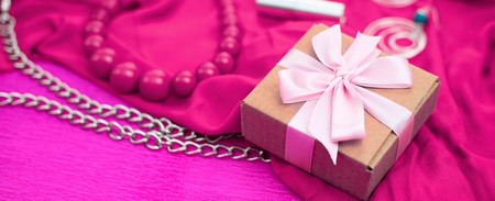 Banner Gifts Packed in Kraft boxes tied with satin ribbon. A set of womens accessories and cosmetics.