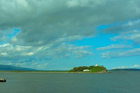 Gloomy seascape line horizon Sea Lighthouse. Natural background Stock Photo
