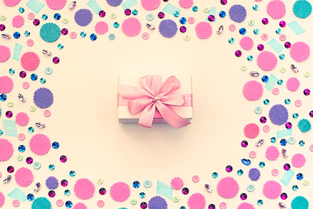 Gift box on festive pastel background. Flat lay top view Archivio Fotografico